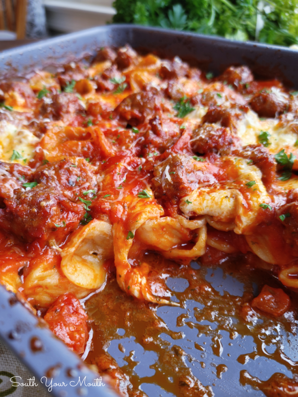 No-Boil, No-Brown Italian Sausage & Pasta Bake - An easy one-dish recipe using uncooked pasta, raw sausage, pantry ingredients and fresh mozzarella that bakes into a cheesy, saucy Italian casserole with perfectly al dente pasta, browned sausage and gooey, melted cheese.