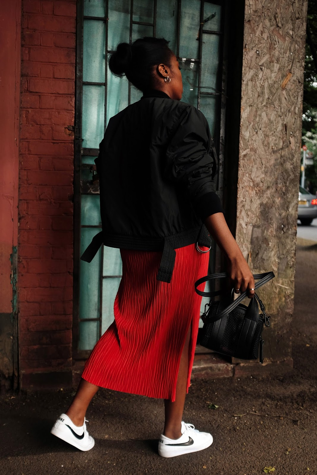 Red H&M Trend Sleeveless Pleated Dress, H&M Trend Bomber Jacket, Nike Classic Tennis AC Sneakers