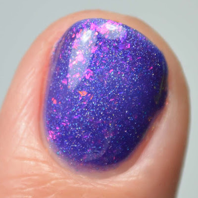purple flakie nail polish close up swatch