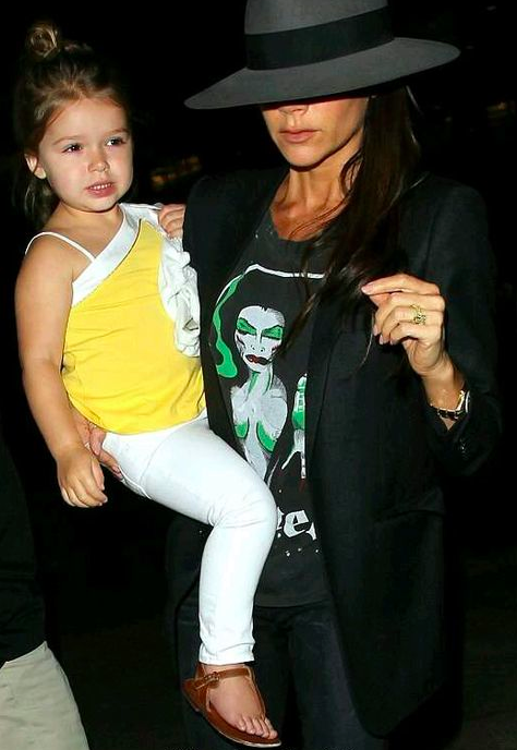 b6ef58245 Harper Seven Beckham and Family pictured arriving to LAX airport on July  17th 2014.