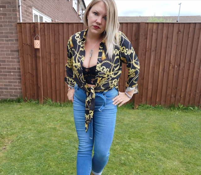 chain print shirt and jeans