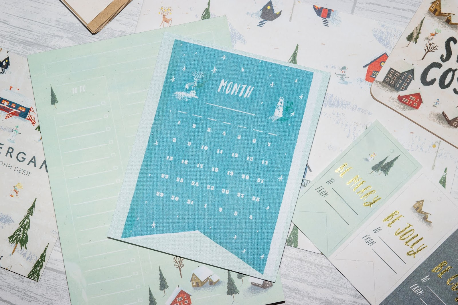 A month of the year card with a bright blue snowy design.