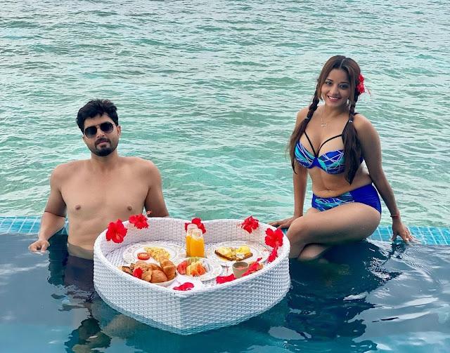 Monalisa enjoys floating breakfast in blue bikini
