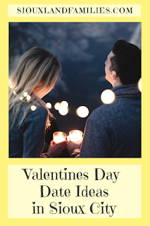 "a yellow rectangle says ""SiouxlandFamilies.com"" at the top, a picture of a man and woman gazing at each other in the center, and the words ""Valentines Day Date Ideas in Sioux City"" at the bottom"