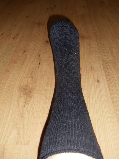 heat holder sock on a mans foot