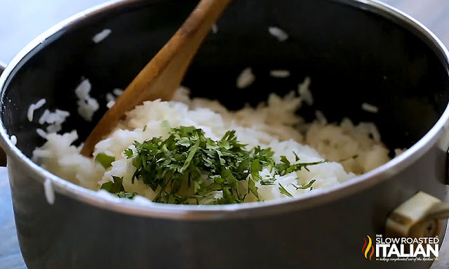 Chipotle Rice Recipe stirring in cilantro