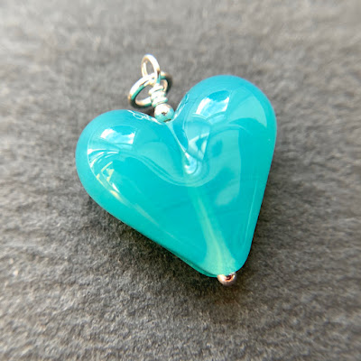 Handmade lampwork glass heart bead pendant by Laura Sparling made with CiM Ice Mint