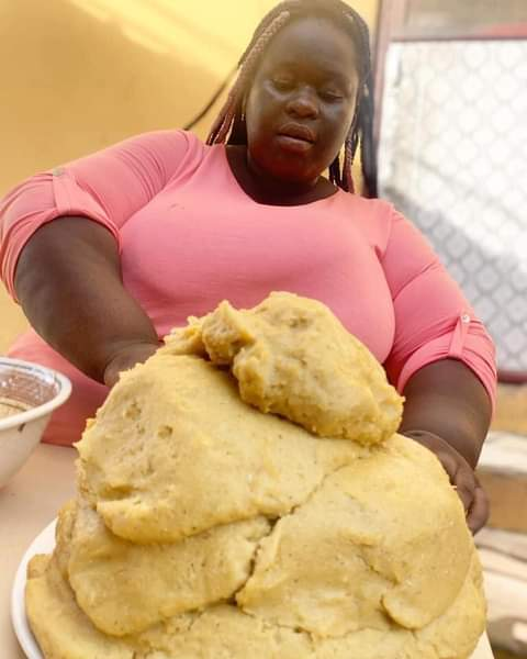 These pictures of a fat woman eating a mountain of banku will shock you. (PICTURES)