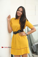 Actress Poojitha Stills in Yellow Short Dress at Darshakudu Movie Teaser Launch .COM 0124.JPG