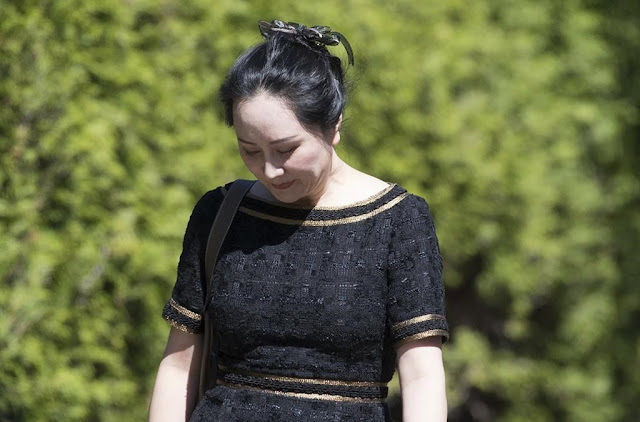 Image Attribute: Meng Wanzhou, the chief financial officer of Huawei, leaves her home to go to B.C. Supreme Court in Vancouver, Wednesday, May 27, 2020. THE CANADIAN PRESS/Jonathan Hayward