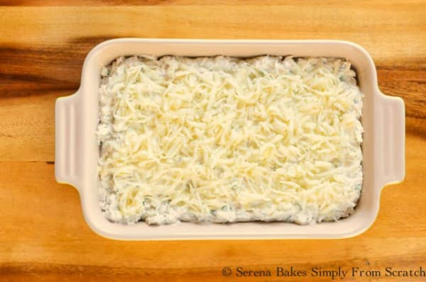 Hot Seafood Artichoke Dip covered with fontina cheese.