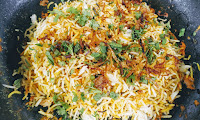 Topped rice with mint Cilantro and fried onions for restaurant style veg biryani recipe