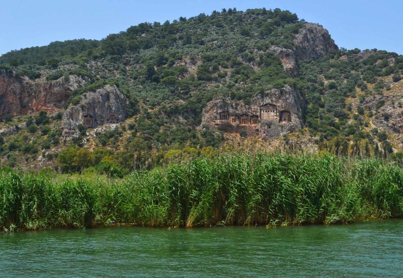 a large hill at Dalyan with carvings in the style of temples in the side