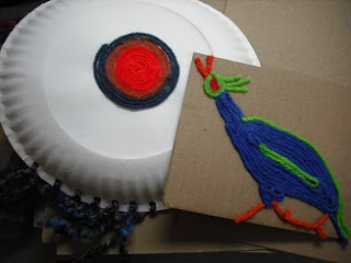 pictures--bird and circle--made with pieces of yarn