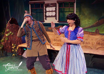Eric Fagan, the Huntsman, is grabbing his nose in pain because Aja Grooms, Snow White, has just karate chopped him in the face.