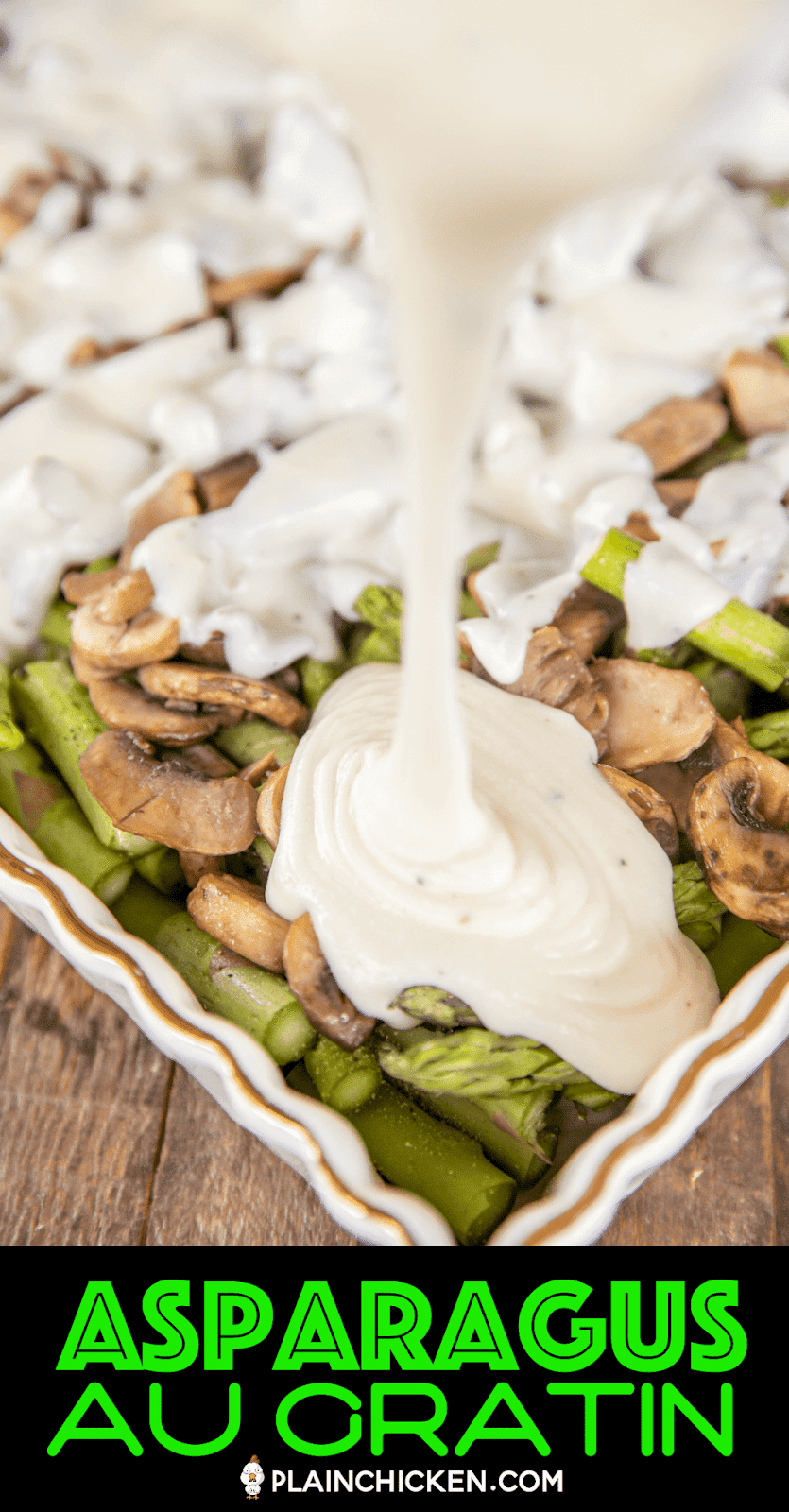 pouring cheese sauce over asparagus and mushrooms
