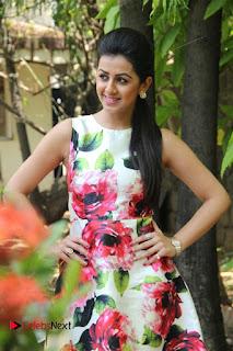 Actress Nikki Galrani Stills in Floral Dress at Velainu Vandhutta Vellaikaaran Press Meet  0010.jpg