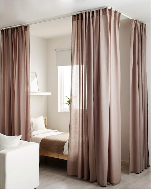 hanging bed curtains from ceiling to separate a room