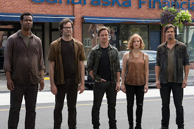 "Mike (Isaiah Mustafa), Richie (Bill Hader), Bill (James McAvoy), Beverly (Jessica Chastain), and Ben (Jay Ryan) stand in the middle of an empty street in Derry, Maine in a movie still for ""It Chapter Two"" (2019)"