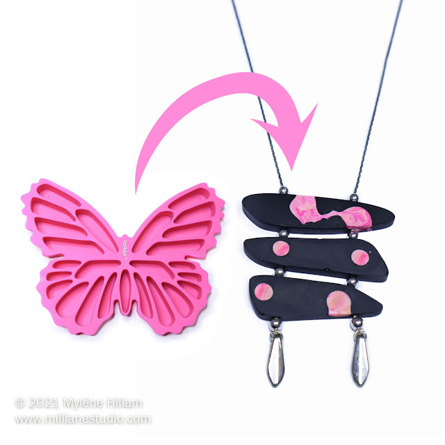 pink silicone butterfly ice cube tray alongside a black resin ladder necklace dotted with pink and apricot resin swirls