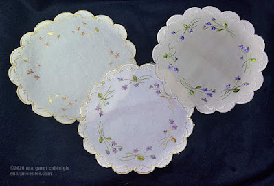 Society Silk Violets: Two antique and one newly-stitched version of the same Society Silk violet design