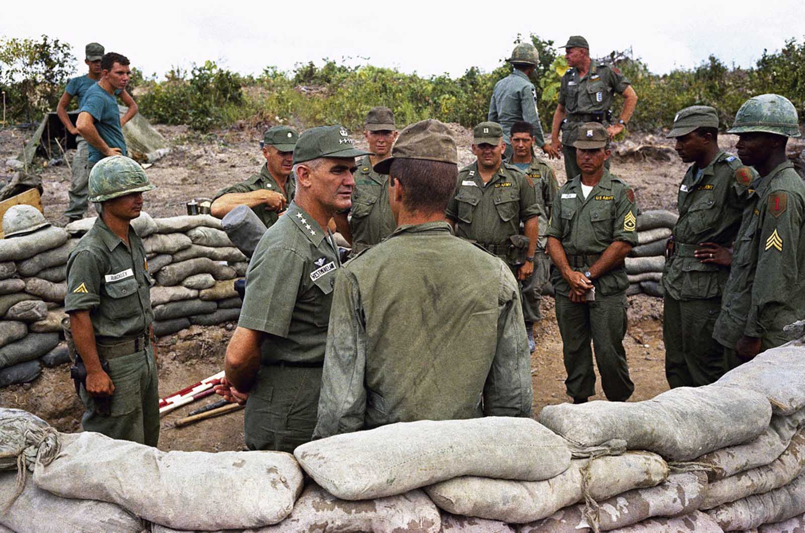 General William Westmoreland talks with troops of first battalion, 16th regiment of 2nd brigade of U.S. First Division at their positions near Bien Hoa in Vietnam, in 1965.