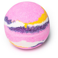 A white and pink spherical bath bomb with a light pink strip in the middle of it on w bright background