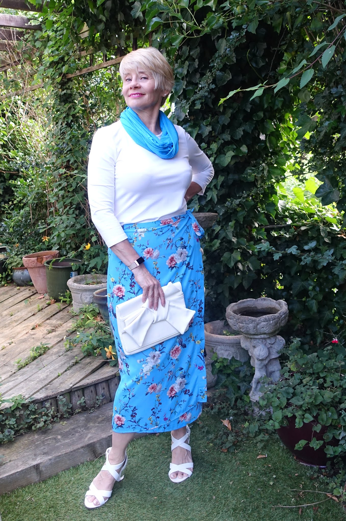 Style for the woman over 60. Gail Hanlon from Is This Mutton adds white accessories and a Chinese Blue scarf to a floral Chinese Blue midi skirt