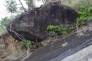 Giant boulder resting on steep slope