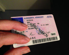 [Image: A hand holding a Finnish driver's license card with blurred details and the text 'specimen' across it.]