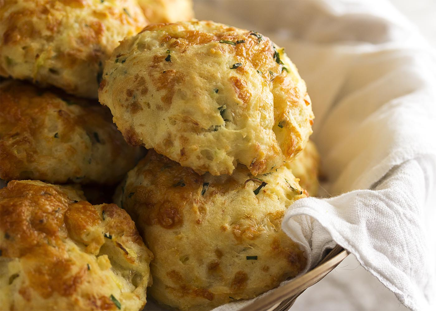 They are extra moist from the zucchini, tangy from the cheese and buttermilk, and have a little zing from the fresh herbs. These are drop biscuits taken to the next level!