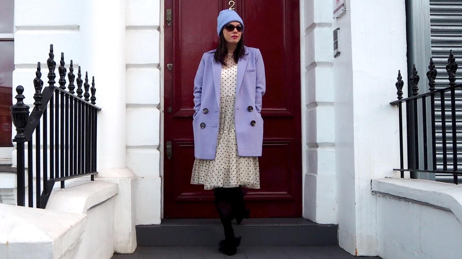 lavender coat & hat with black & beige polka dot dress