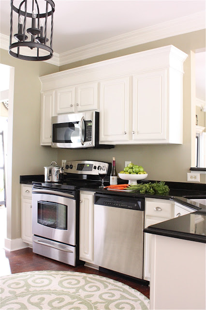 add molding to kitchen cabinets
