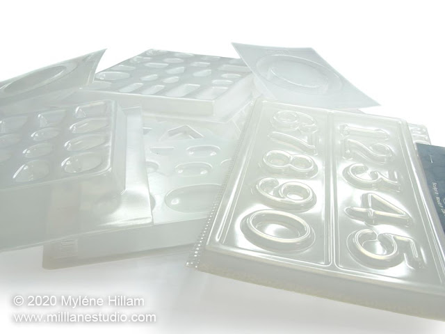 Selection of plastic resin moulds in a pile