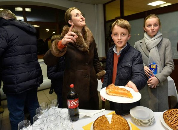 Prince Laurent, Princess Claire, Prince Nicolas, Prince Aymeric and Princess Louise of Belgium visited a shelter for the homeless and their dogs