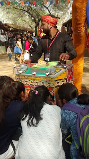 People enjoying Biscope at Surajkund Crafts Fair