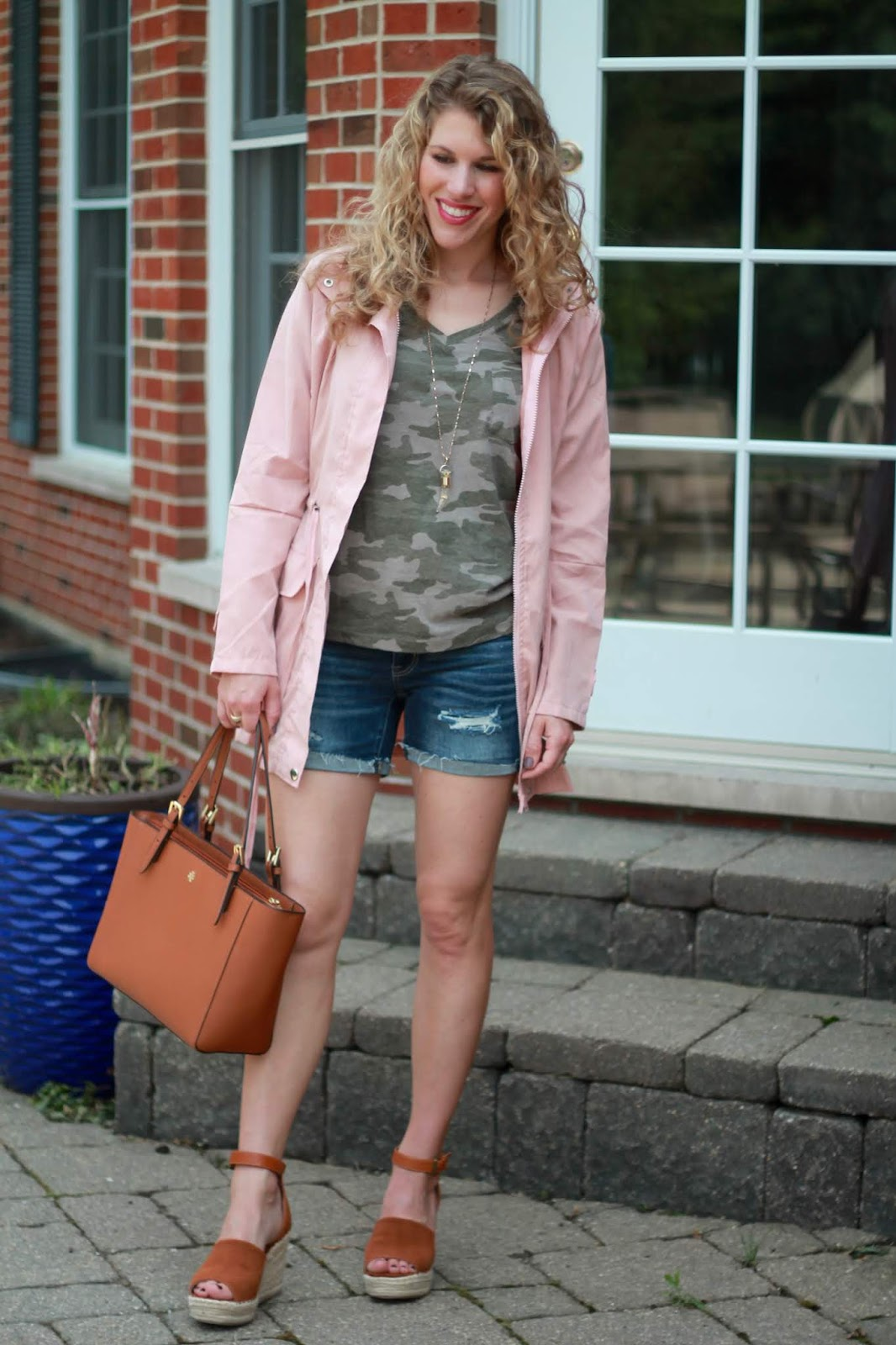 camo tee, AE distressed denim shorts, cognac wedges, Tory Burch tote, pink utility jacket