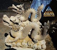 Patung naga dari batu alam paras jogja / batu alam paras putih.