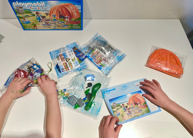 The contents of the Family Camping Trip set straight from the box includes several clear bags with small pieces in and instructions for assembly
