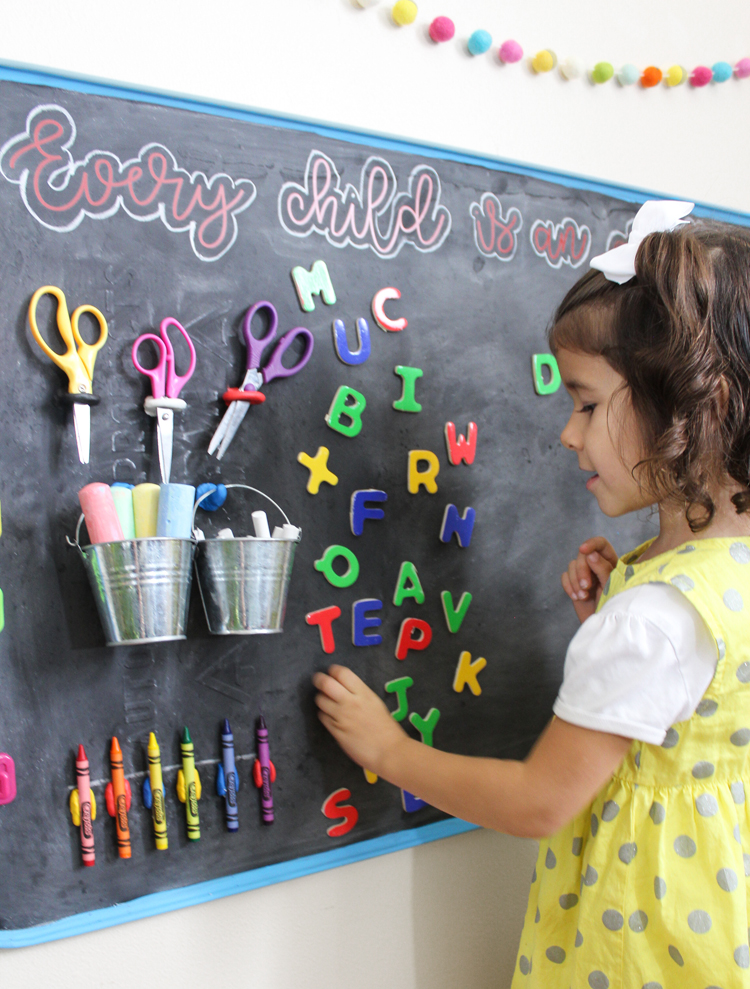 Make a magnetic chalkboard art station for your little artist.