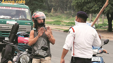 Challan of 500 rupees for a lawyer driving a car alone without a mask, demanded 10 lakh compensation from the government