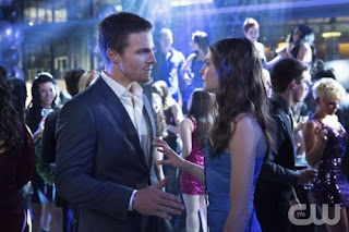 Stephen Amell and Willa Holland as Oliver Queen/Arrow and Thea Queen/Speedy in Arrow Pilot Episode