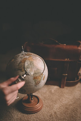 Photo of a globe with a magnifying glass