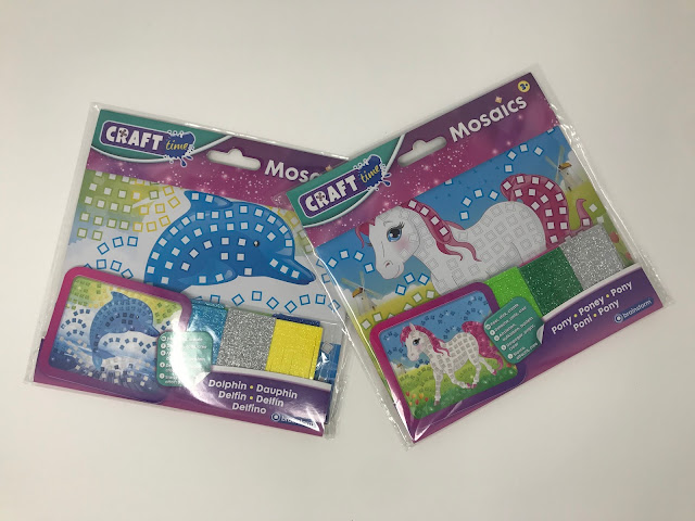 The Dolphin and Pony mosaic sets in their packaging