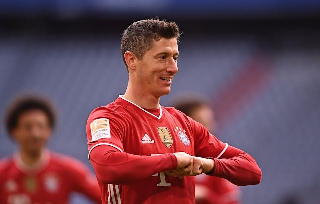 Bayern Munich's Robert Lewandowski celebrating his hat-trick against Stuttgart