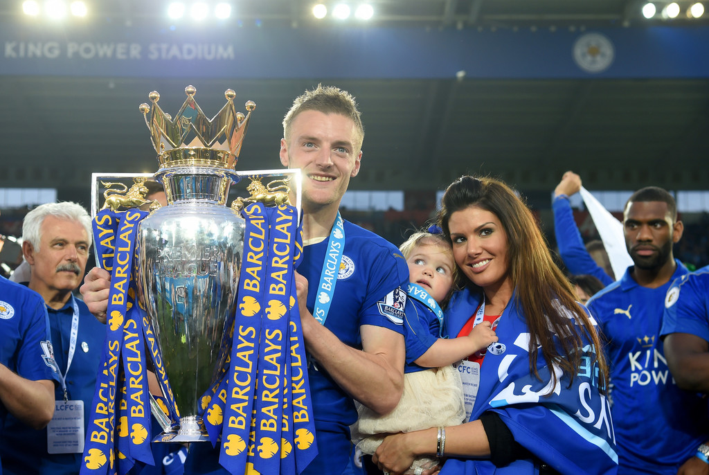 Jamie Vardy of Leicester City poses with the Premier League Trophy with his family after the Barclays Premier League match between Leicester City and Everton at The King Power Stadium on May 7, 2016 in Leicester, United Kingdom