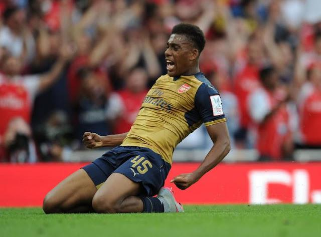 Alex Iwobi celebrates scoring for Arsenal