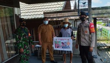 Kegiatan Operasi Yustisi Covid-19. Babinsa bersama Bhabinkamtibmas dan Perangkat Desa Rangga Ilung Kecamatan Jenamas Kabupaten Barito Selatan