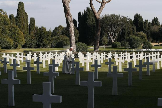 The Pope rested a white rose on about a dozen graves at the Sicily-Rome American Cemetery.