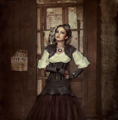Steampunk women's clothing, a feminine gray/brown tweed suit with matching corset, skirt, gloves and jacket.